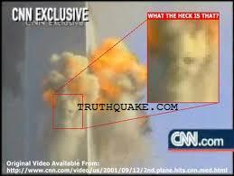 Twin Towers Being Attacked on 9/11: Demon Face Seen in Explosion Clouds